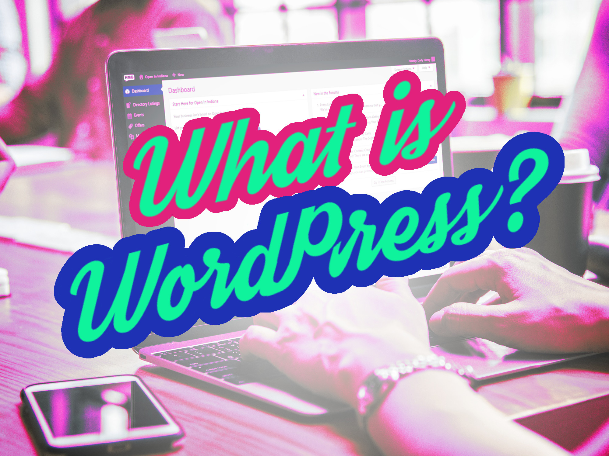 What is WordPress in green text, over pink and blue outlines, over an image of someone's hands using WordPress on a laptop.